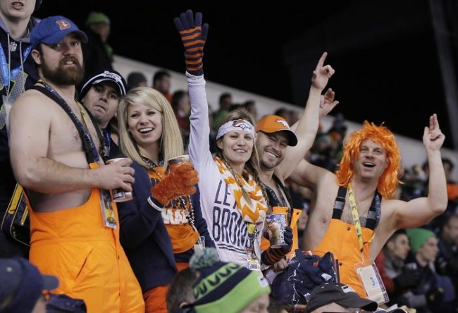 Denver Broncos fans cheer during the first quarter as the Broncos play the Seattle Seahawks in the NFL Super Bowl XLVIII football game in East Rutherford, New Jersey, February 2, 2014. (Reuters)