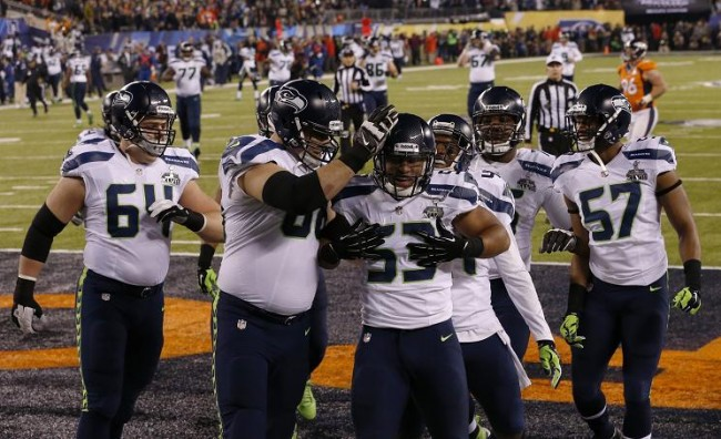 Seattle Seahawks outside linebacker Malcolm Smith (53) and cornerback Byron Maxwell (41) celebrate a touchdown during the first half against the Denver Broncos in Super Bowl XLVIII at MetLife Stadium. (Reuters)