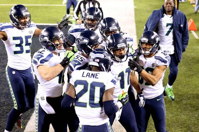 Seattle Seahawks wide receiver Percy Harvin (11) celebrates with teammates after returning a kick for a touchdown against the Denver Broncos in the third quarter in Super Bowl XLVIII at MetLife Stadium. (Reuters)