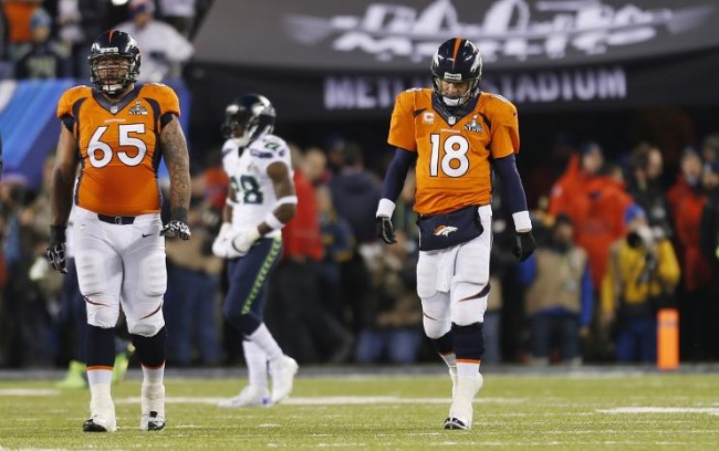 Denver Broncos quarterback Peyton Manning (18) walks with teammate Louis Vasquez, looking dejected after a play against the Seattle Seahawks during the second quarter in the NFL Super Bowl XLVIII football game in East Rutherford, New Jersey, February 2, 2014. (Reuters)