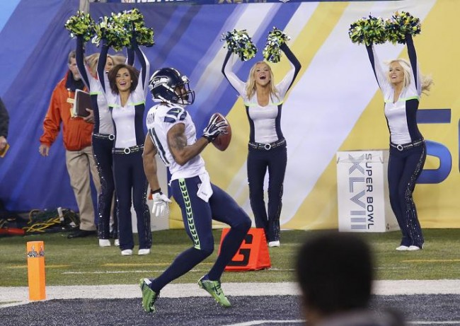 Seattle Seahawks cheerleaders root on Percy Harvin as he scores a touchdown on a kick off return against the Denver Broncos in the third quarter. (Reuters)