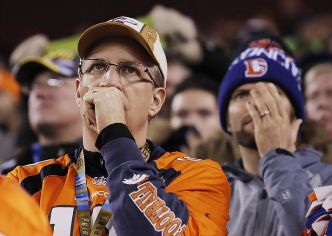 Denver Broncos fans react during the third quarter against the Seattle Seahawks during the NFL Super Bowl XLVIII football game in East Rutherford, New Jersey, February 2, 2014.