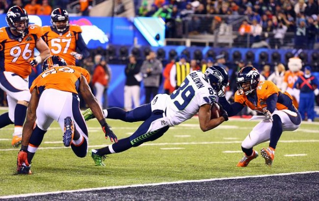 Seattle Seahawks wide receiver Doug Baldwin (89) dives in for a touchdown past Denver Broncos free safety Mike Adams (20) in the fourth quarter in Super Bowl XLVIII at MetLife Stadium. (REUTERS)