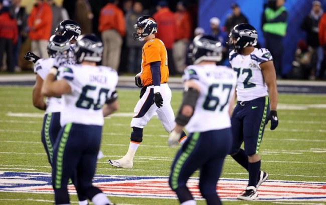 Denver Broncos quarterback Peyton Manning (18) reacts after a failed fourth down attempt against the Seattle Seahawks in the fourth quarter in Super Bowl XLVIII at MetLife Stadium. Mandatory Credit: Joe Camporeale-USA TODAY Sports