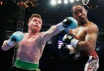 Canelo Alvarez of Mexico (L) delivers a punch to James Kirkland
