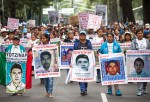 Protest In Mexico City Marks One Year Anniversary Of Missing Students