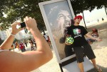 Fans mock Luis Suarez biting incident in Brazil during the 2014 World Cup