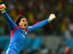 Guillermo Ochoa celebrates Mexico's goal against Croatia