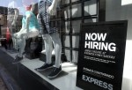 A now hiring sign is posted in the window of a clothing store on June 6, 2014 in San Francisco, California. According the Labor Department, the hiring pace remained strong for the fourth straight month with employers adding 217,000 jobs in May.