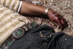 A marijuana themed belt adorns the victim of an apparent drug-related execution.