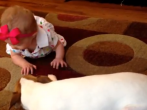 What this puppy does for this baby is just about the sweetest thing ever.