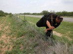 Brooks County Sheriff's Deputy Moe Saavdra tracks fresh footprints while searching for undocumented immigrants on May 23, 2013 near Falfurrias, Texas.