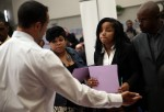 Job seekers meet with a recruiter during a career fair at the Southeast Community Facility Commission on May 21, 2014 in San Francisco, California. Job