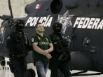 Edgar 'La Barbie' Valdez Villarreal is shown to the press during a news conference at the federal police center August 31, 2010 in Mexico City, Mexico