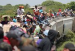 Central American immigrants ride north on top of a freight train on August 6, 2013 near Juchitan, Mexico.