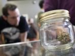 Customers shop for marijuana at Top Shelf Cannabis, a retail marijuana store, on July 8, 2014 in Bellingham, Washington.