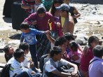 Undocumented Guatemalans prepare to cross the Suchiate River from Guatemala into Mexico on August 1, 2013 in Talisman, Mexico.