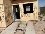 An abandoned home is viewed on March 21, 2010 in Juarez, The border city of Juarez has suffered from the duel effects of the recession in America and the surge in drug violence. An estimated 100,000 jobs having been lost since the recession and some 10,00