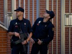 Two Spanish policemen guard a residence at Rutilo street during an operation against an international Jihadist recruiting network on June 16, 2014 in Madrid, Spain.
