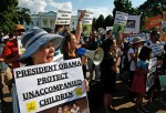 Immigration reform protesters gather in front of the White House on July 17, 2014 in Washington, DC.