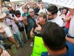 Pro-Immigration activist Ricardo Reyes yells at anti-immigration activists during a protest along Mt. Lemmon Road in anticipation of buses carrying illegal immigrants on Jully 15, 2014 in Oracle, Arizona. About 300 protesters lined the road waiting for a
