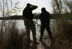 U.S. Customs and Border Protection agents look for suspected drug smugglers along the Rio Grande River on April 11, 2013 in Mission, Texas.