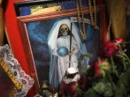 A painting of 'Santo Muerte' sits on display at Acapulco's central market on March 4, 2012 in Acapulco, Mexico. The cult of Santo Muerte, officially condemned by the Catholic church, has grown in recent years, especially in Mexico's lower classes and crim