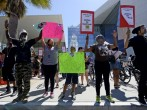 Demonstrators march in downtown Los Angeles protesting the police shooting death of 24-year-old Ezell Ford earlier in the week August 17, 2014, in Los Angeles, California. Several hundred protestors rallied in front of the Los Angeles Police Department he